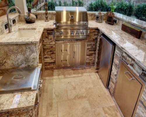 Granite on Countertops, Floors, & Walls of Outdoor Kitchen Design