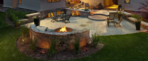 Curved Rock Wall around Fire Pit in Backyard Patio