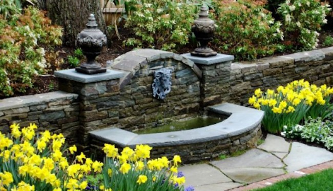 Rock Fountain in Stone Boundary Wall