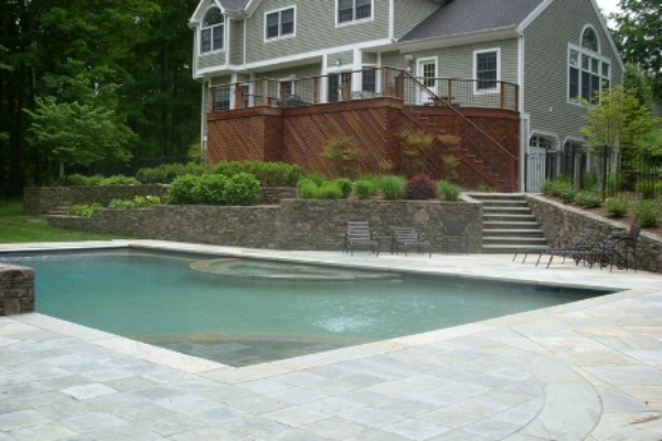 Swimming pool deck with natural quartzite stones