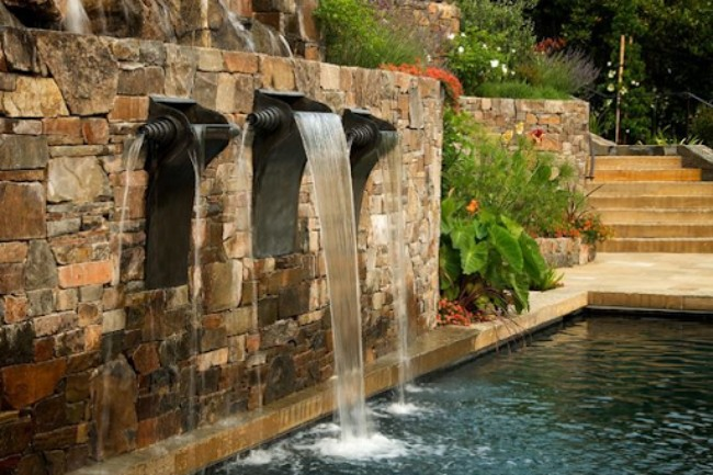 Tudor Realm on the Stone Wall of a Water Feature