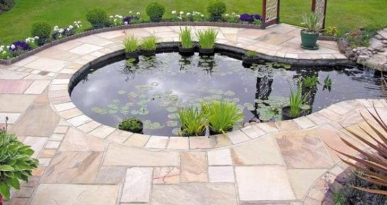 Sandstone paving around the garden pond