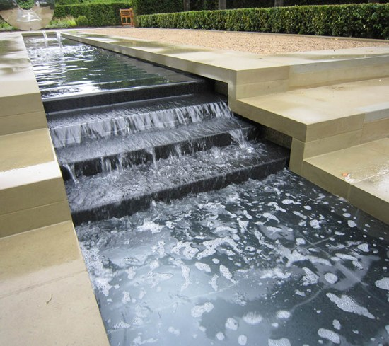 Sandstone paving around water feature